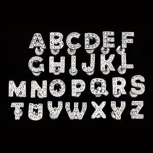 Piercing do jazyka z oceli - písmeno se zirkony - Písmeno: U obraz