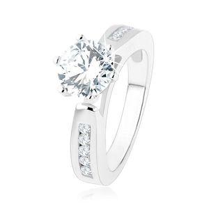 Zásnubní prsten, zdobená ramena, kulatý čirý zirkon, výřezy, stříbro 925 - Velikost: 54 obraz