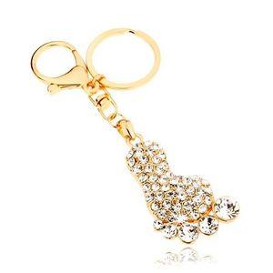 Přívěsek na klíče ve zlaté barvě, třpytivé chodidlo, čiré zirkony obraz