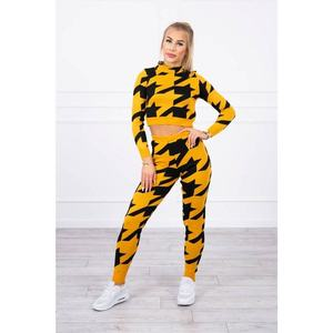 Sweater set in a houndstooth mustard obraz